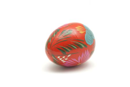 Wooden painted Easter egg isolated on white background