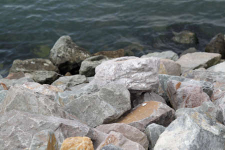 Stones near the water on cloudy day