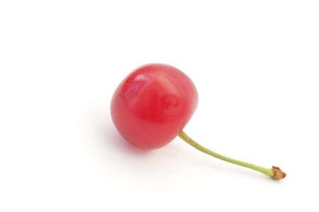 Single ripe cherry isolated on white background