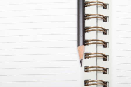 黒の鉛筆が並ぶスパイラル日記 写真素材
