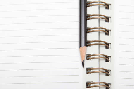 Lined spiral diary with a black pencil