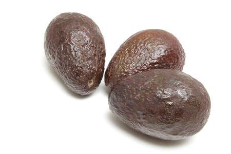 Three avocado fruits isolated on white background photo