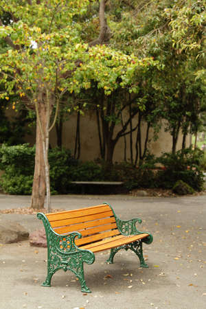 An orange bench in the park at autumn