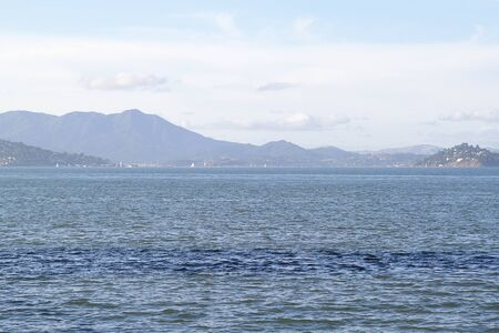 Seascape in San Francisco bay with mountains on background Stock Photo
