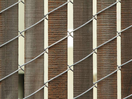 Closeup photo of wooden fence with wire Stock Photo - 8836697