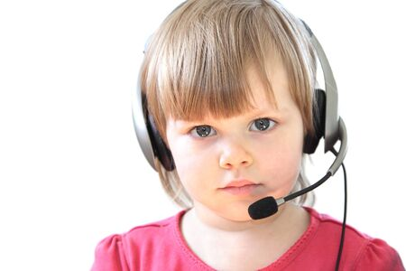 Cute toddler girl with a headset over white background photo