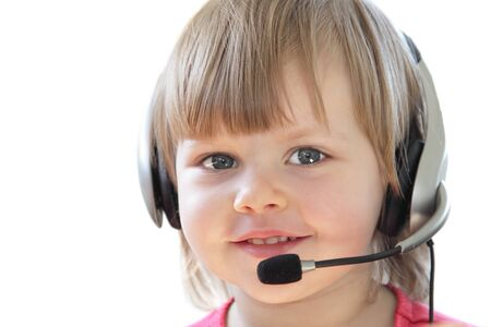 Little cute girl with a headset and microphone photo