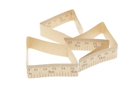 Paper measuring tape with inch and centimeter marks isolated on white background