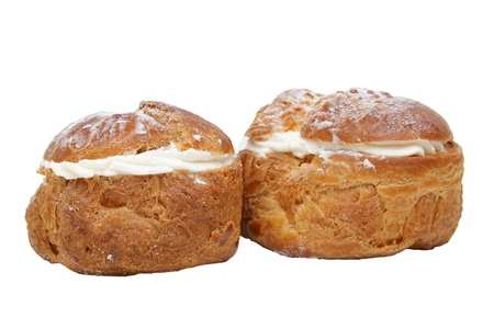 Two profiteroles isolated on the white background