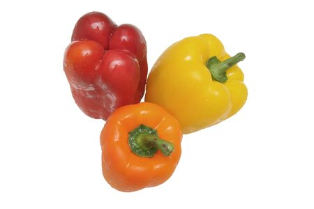 Three peppers of different colors isolated on white background