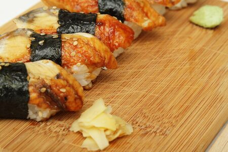 Close up photo of broiled eel (unagi) sushi