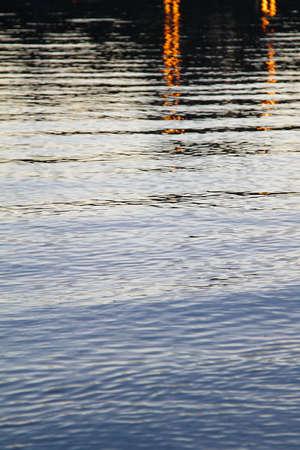 夕方の黒い影と青い水 写真素材