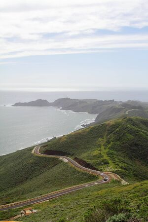 A road on hills by the ocean