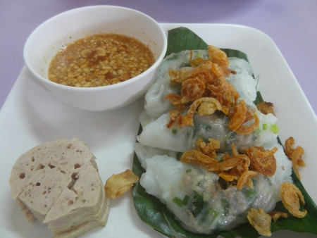 Banh cuon, vietnamese steamed rice noodle roll, vietnamese popular breakfast food photo