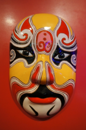 facial painting: chinese traditional opera facial painting with red isolated background Stock Photo