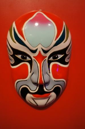 chinese traditional opera facial painting with red isolated background photo