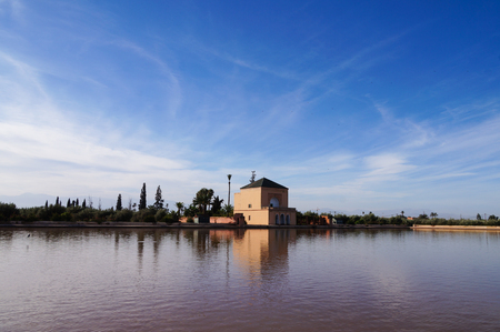 Pavillion reflection on Menara Gardens basin at Marrakech, Morocco Stock Photo