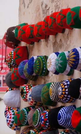 Morocco Marrakesh medina - typical colorful knitted Moroccan hats on display for sale