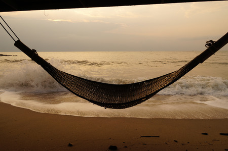 Beach bamboo cradle hanging by the sea ,Thailand photo