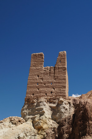 Amazing scenic view - lonely ruined tower of ancient Basgo fortress against blue sky, Ladakh, Jammu   Kashmir, Northern India