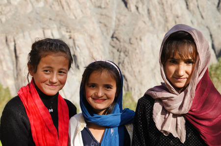 3 lovely girls smiling at Hussaini Village,Passu,Pakistan