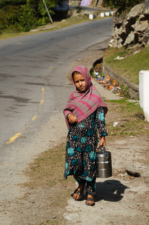 pakistani pakistan: Pakistani girl with food carrier at Lunch time in Pakistan