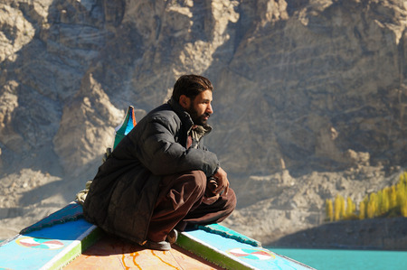 pakistani pakistan: Pakistani man at the boat,Attabad Lake,Northern Pakistan Editorial