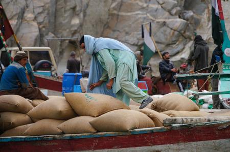 pakistani pakistan: Pakistani man working at the boat,Attabad Lake,Northern Pakistan