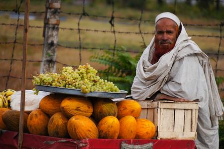 pakistani pakistan: Unidentified Pakistani man sells fresh fruits at market on October 20, 2014 in  Pakistan.