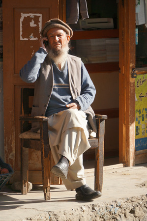 pakistani pakistan: Old Pakistani man Talking on his cellphone,Northern Pakistan Editorial