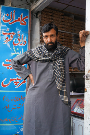pakistani pakistan: Pakistani man in front of nut shop in Gilgit,Northern area of  Pakistan