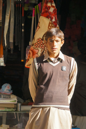 pakistani pakistan: Young Pakistani man  in front of a shop near Chilas,Northern area of Pakistan