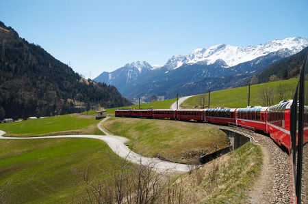 Beautiful view and Bernina express train from Switzerland to Tirano Editorial