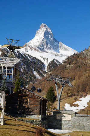 climbing cable: Cable car climbing up with Matterhorn in the background in Zermatt, Switzerland.