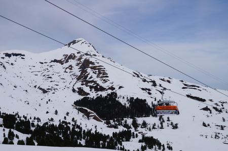 jungfraujoch: Orange cable car on the way to Jungfraujoch in Switzerland