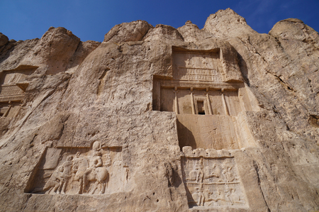 stone carvings: Stone carvings in bas-relief on the Tomb of Darius the Great, at Persepolis, near Shiraz, in Iran. Persepolis became a UNESCO World Heritage Site in 1979.
