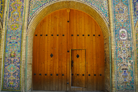 old wooden door: Renovated old gate, Golestan palace, Tehran, Iran Editorial