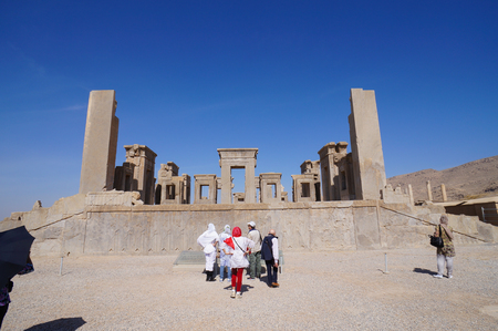 shiraz: Shiraz,Iran - October 27,2015:Unknown tourists visiting the ruins in Persepolis, Shiraz, Iran. Persepolis was the ceremonial capital of the Achaemenid Empire. Editorial