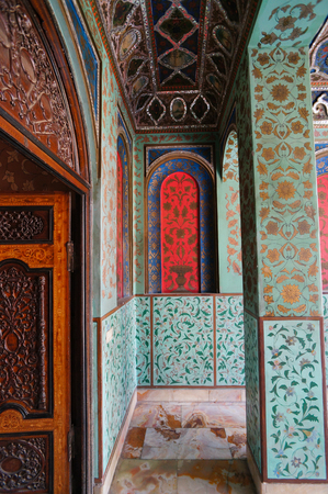 belongs: Traditional Persian design of Golestan Palace with painted walls, tiles and wooden doors, Tehran, Iran. The Golestan Palace belongs to royal buildings became the world heritage site of UNESCO Editorial