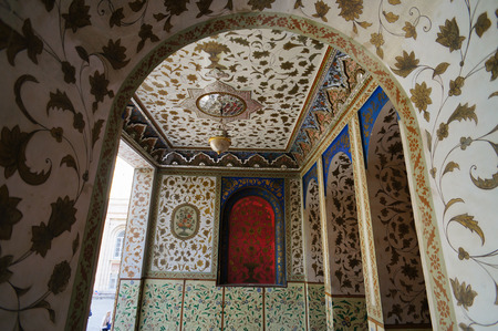 tiled: Traditional Persian design of Golestan Palace with painted walls, tiles and wooden doors, Tehran, Iran.