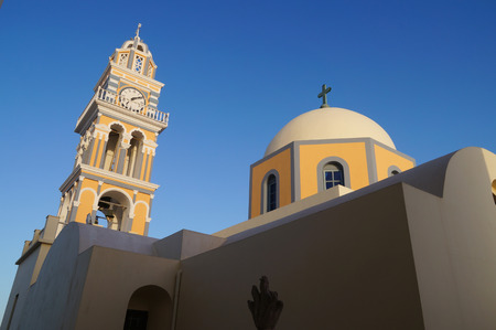 fira: Catholic Cathedral with dome and belfry, Fira (Thera), Santorini, Greece.