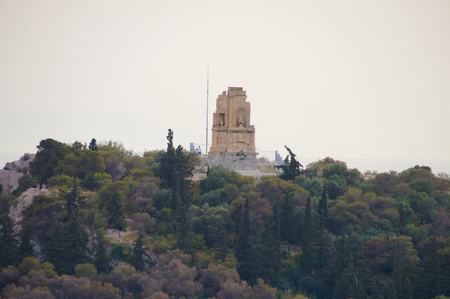 house of god: Monument of Filopappos (or Philopappos) seen from the Acropolis in Athens,Greece.