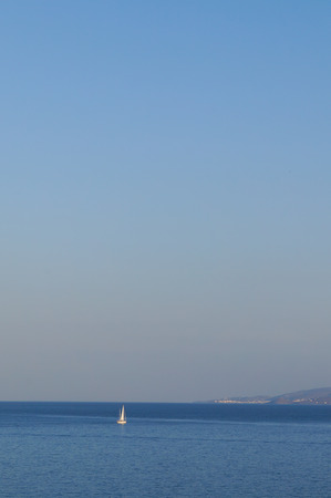 spinnaker: White sail yacht sailing in a calm sea,Mykonos,Greece.