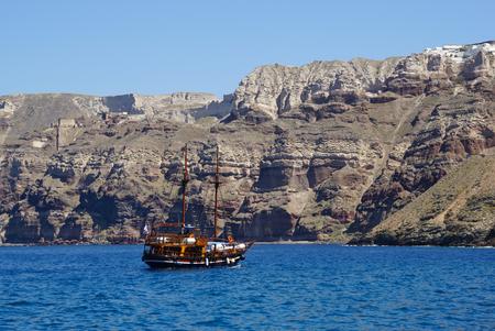 fira: Traditional sailing boat in Aegean Sea,Santorini, Greece