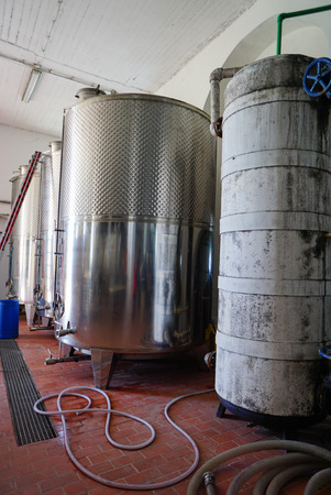 stell: Equipment of contemporary winemaker factory with stell barrels in Pyrgos,Santorini,Greece.