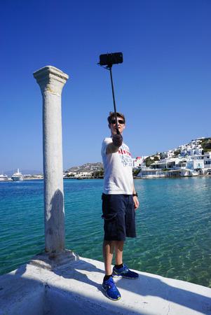 myconos: Mykonos,Greece- April 12,2016:Unidentified tourist taking photograph at Little Venice in Mykonos, Greece.
