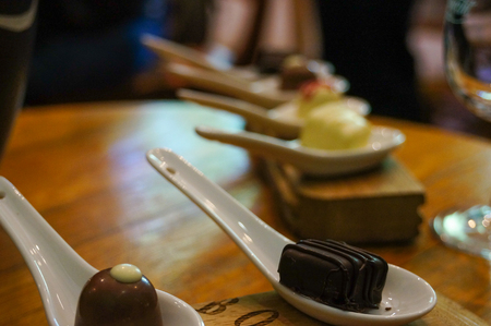Chocolate in white spoons for testing wine,South Africa.