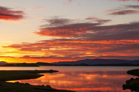 erupting: Beautiful sunset at Lake Myvatn in Iceland.
