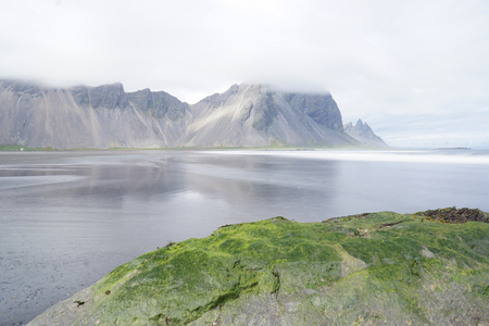 Mountains of the Vestrahorn with cloud on top holding  in Iceland