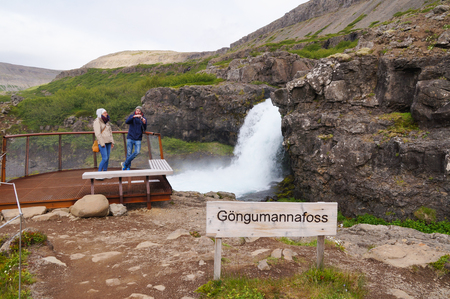 west river: West Fjords,Iceland- 27 June 2017: Unidentified tourists taking picture of small waterfall near Dynjandi Waterfall,Iceland. Editorial